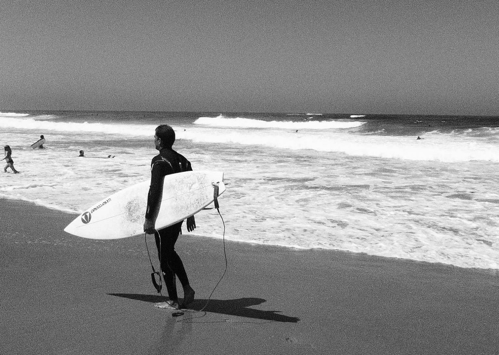 Surfer on the beach in Morocco|The Spot Morocco, Taghazout, surf camp, surf Morocco, surf in Morocco, Morocco surf, where to surf in Morocco, surfing Morocco
